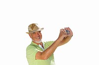 Senior man in straw hat taking a photograph, cut out (thumbnail)