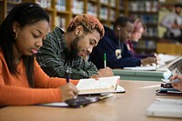 Teenage students studying in school library