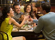 Two couples having dinner in restaurant