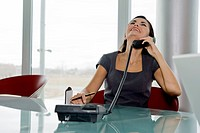 Professional woman on telephone (thumbnail)