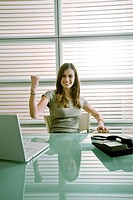 Happy businesswoman at desk