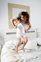 Girl jumping on bed (thumbnail)