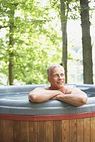 Man Soaking in Hot Tub