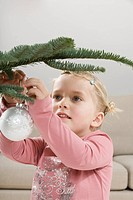 Little girl 3_4 holding Christmas bauble