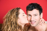 Young couple, woman kissing man, portrait