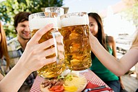 Germany, Bavaria, Upper Bavaria, Young people in beer garden, close_up