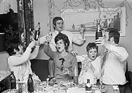 Seventies, black and white photo, people, night of New Years Eve, celebrating New Years, fun, laughing, singing, alcohol, three women, aged 18 to 25 y...