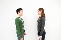 A man and woman facing each other