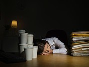 Woman sleeping in office (thumbnail)