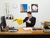 Businessman with giant hand