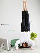 Businessman standing on head