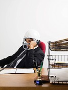 Businessman on telephone in american football helmet