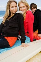 Teenagers with surfboard