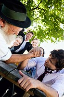 Germany, Bavaria, Upper Bavaria, Two men in beergarden arm wrestling