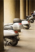 Mopeds in a row