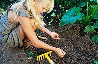 Girl planting seeds