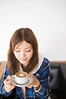 Young woman with cappuccino