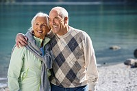Germany, Bavaria, Walchensee, Senior couple embracing, smiling