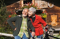 Austria, Karwendel, Senior couple in front of log cabin