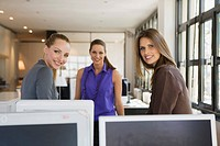 Three women in office (thumbnail)