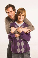 Father and son 13_14, Man embracing boy, portrait