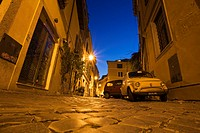 Italy, Rome, Trastevere, Lane with parking cars