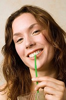 Young woman, Holding glass and straw, smiling, close up