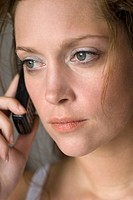 Young woman using mobile phone, close up