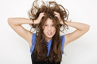 Young woman 16_17 tearing her hair