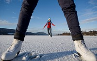Austria, Salzkammergut, Lake Irrsee, Female teenagers 14_15 skating