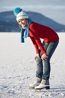Austria, Salzkammergut, Lake Irrsee, Female teenager 14_15 on skates, smiling