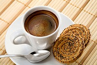 A cup of espresso with cookies