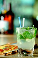 Glass of Mojito/ Caipirinha alcohol drink with fresh mint leaves
