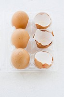 Eggs and Egg shells in egg box, elevated view
