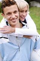 Teenage couple, smiling, embracing, happy, young a (thumbnail)