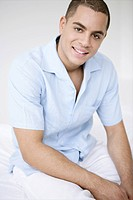 young, man, smiling, gentle, sitting, bed, white,