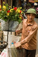 flower vendor and his bicycle in Hanoi Vietnam