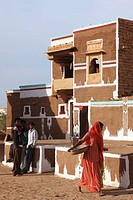 India, Rajasthan, Jaisalmer, traditional painted house, people