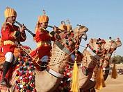 India, Rajasthan, Jaisalmer, Desert Festival, musicians on camelback