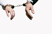 close up of woman and man handcuffed together