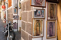 Sales of religious paintings in the historic center of Puebla. City of Puebla, Mexico