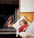 Girl relaxing by fire