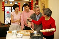 Chinese family making Chinese dumpling on New Year´s Eve