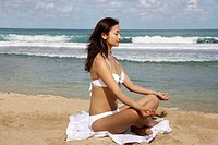 Chinese Young Woman Doing Yoga On The Beach,America
