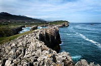 Cliffs of Buelna with Pendueles and Picos de Europa in background, Llanes. Asturias, Spain