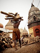 Men carrying firewood for a cremation ceremony, Manikarnika ghat, Varanasi, Uttar Pradesh, India