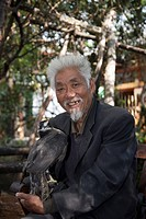 Man with hawk, Lijiang, Yunnan Province, China, Asia