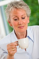 Older female person drinking coffee