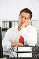 Man in the office being overworked