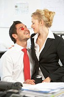 Young couple in love in the office